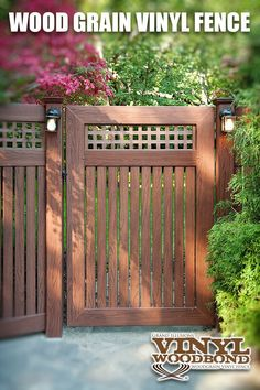 """This terrific Illusions Vinyl Fence CUSTOM VWG5215SQ-46 gate with 7/8"""" x 3"""" pickets and square lattice is shown in Grand Illusions Vinyl WoodBond Rosewood (W104). This particular customer had a cool fun backyard idea to put lights in their fence. FYI - Il"""