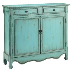 With an aged blue finish and interior storage, this 2-drawer wood cabinet brings eye-catching style to your living room or parlor. Let it act as a bar stocke...