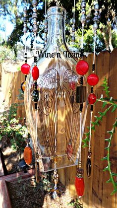 This is an original, one-of-a-kind wind chime. Made from a recycled Angels Envy Rye bottle with beautiful Angel Wings on one side. It has been