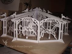 Hand cut papercut 3D Carousel by Mad March Moon Designs. 12 interlocked papercut pages form the carousel. Soon to be available as a construct it yourself book with 12 pre cut sections and a handbound cover. Can be suspended from ceiling when complete. Approx 50cm wide.
