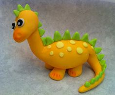 Fondant Baby Dinosaur Cake or Cupcake topper - Decorations for your Prehistoric party. $21.00, via Etsy.