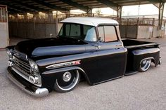 Black 1959 Chevrolet Apache step-side lowered