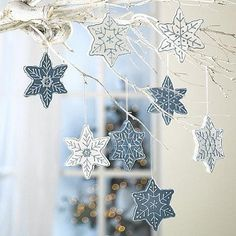Love the idea of white branches with dangling snowflakes... make 'em COOKIE snowflakes and it becomes the BEST IDEA EVER!  Totally gonna do this in my kitchen this year!
