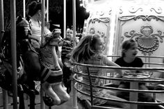 April 29, 2012. Carousel. Downtown Disney.  Children become knights and princesses for a few instants one evening at Downtown Disney.