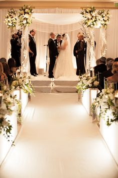 Beautiful white floral chuppah and aisle markers | Flowers By Tony | Roy Llera Photography