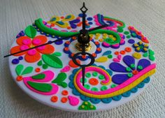 Upcycled CD Wall Clock, polymer clay, Flowers and Paisley, recycled clock. $39.00, via Etsy.