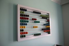 DIY abacus art/functional toy....amazing!!!!  I totally want to put this in the kid's room.