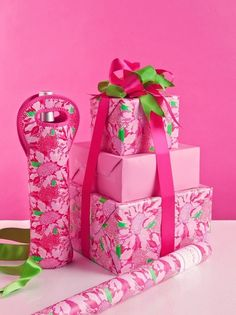 Lilly Pulitzer wrapped gifts!!! Bebe'!!! Pretty in pink Lily wrap with pink and green satin ribbon and bow!!!