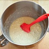 Proof the yeast: Make sure the water is warm to the touch. If you can't comfortably hold your finger in the water for several seconds, wait for it to cool. Pour the water into the bowl of a standing mixer or large bowl and sprinkle the yeast over top. Let this stand for 5 minutes until the yeast is dissolved.