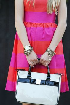 Love the pink and red stripes against the black and white bag.