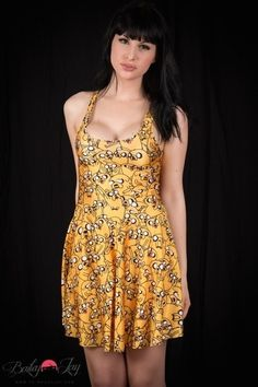 Bailey Jay in a yellow strapless sundress.