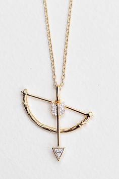 I want this!!  Check out India Hicks.  She's so awesome.  NEW Swinging Bow and Arrow Pendant