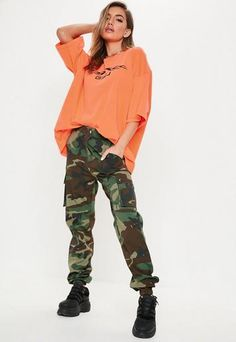 Khaki camo pants featuring two side pockets with button fastening, oversized slouchy fit, elasticated cuff, two back pockets and belt loops. as worn by Leopard Print Pants, Camo Print, Camo Pants Outfit, Joggers Outfit, Camouflage, Fashion Illustration Face, Military Pants, Military Style, Printed Pants