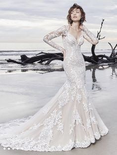 Gorgeous lace motifs cascade over tulle in this chic sleeved wedding gown, completing the illusion long sleeves, V-neckline, and illusion V-back. Fit-and-flare skirt features an illusion double-lace… Wedding Gowns With Sleeves, Couture Wedding Gowns, Wedding Dress Train, Fit And Flare Wedding Dress, Long Sleeve Wedding, Designer Wedding Dresses, Bridal Dresses, Wedding Gown Lace, Gown Designer
