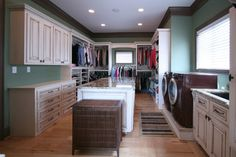 Dream Closet....  Walker Woodworking Custom Cabinets - traditional - laundry room - charlotte - by Walker Woodworking