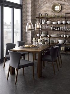 A Dining Table Made Of Raw Edged Wood With Black Chairs