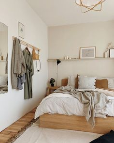 Scandinavian style bedroom light and bright wall to wall shelf over bed peg rail IKEA MALM bed by Hemma Interiors Bedroom Inspo, Home Bedroom, Bedroom Furniture, Ikea Bedroom Design, Adult Bedroom Ideas, Bright Bedroom Ideas, Cheap Bedroom Ideas, Furniture Design, 1 Bedroom Flat