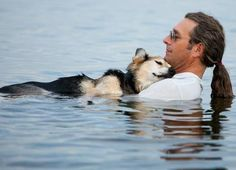 In loving arms: Man floats his sick dog to sleep!!