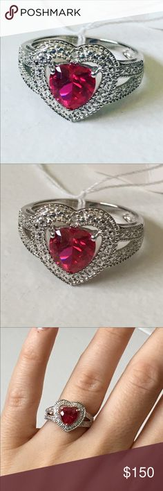 NWT Sterling Silver & Ruby Heart Ring Size 7 Sterling silver with a red ruby heart-shaped stone. Size 7. Stone is .10 ct genuine ruby. Jewelry Rings