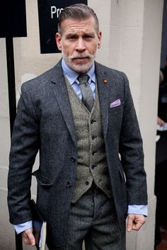 Nick Wooster in a sharp grew wool suit