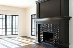 10 Powerful Clever Tips: Living Room Remodel With Fireplace Spaces small living room remodel apartments.Small Living Room Remodel Organization Ideas living room remodel with fireplace products.Living Room Remodel With Fireplace Basements. Black Fireplace Mantels, Black Fireplace Surround, Fireplace Wall, Living Room With Fireplace, Fireplace Surrounds, Living Room Grey, Fireplace Design, Wood Mantle, Subway Tile Fireplace