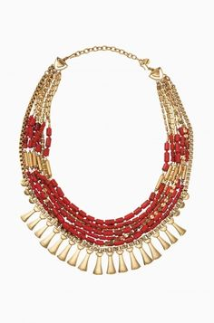 The Bliss Statement Necklace will add a vibrant touch to any outfit. The coral beads and vintage gold chain combine into a fun statement.
