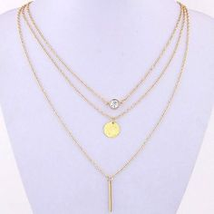 This necklace features three unique chains. The first chain features a…