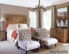 Designer Kay Douglass used an antique door as the headboard in this master bedroom. The walls are Seapearl by Benjamin Moore.