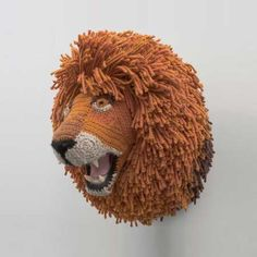 This crochet-knit sculpture of a life-sized lion's head is a witty, whimsical commentary on the sport of hunting and taxidermy's trophy exhibitionism. - by Nathan Vincent, via Fab Crochet Lion, Crochet Art, Crochet Animals, Crochet Dolls, Crochet Patterns, Crocheted Toys, Knit Art, Amigurumi Patterns, Crochet Ideas