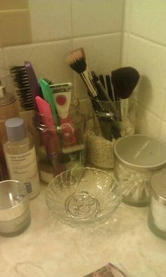 Upcycled my empty Yankee candle jars to a makeup/brush holder.  Can also use for q-tips and cotton balls.