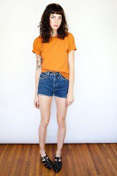 simple style, summer, mustard, yellow t shirt, shorts, fringe, dark brown hairstyle, hair