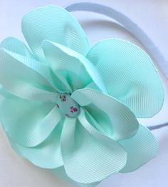 Pastel Aqua Large Flower Hairband by GracefulJane on Etsy https://www.etsy.com/uk/listing/530272163/pastel-aqua-large-flower-hairband