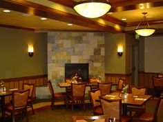 Commercial Dining Hall, Party Room, Slate Stone Fireplace, Wood Wall Paneling, Designer Commercial Carpet, Dining Furniture, Hanging Lights & Wall Sconces, Tray Ceiling