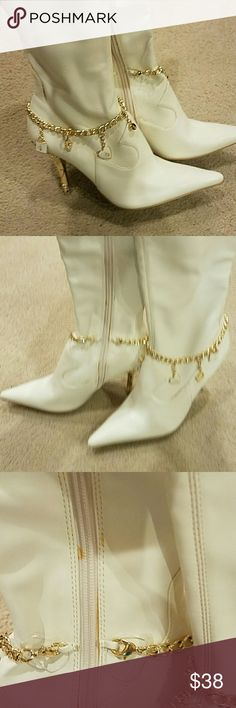 Ceeam knee high boots Bought and worn once, knee high tall cream colored boots by Baby Phat, size 7.5, gold heels which are in pefect shape, some minor marks as shown in photo,gold charms on a gold chain hang on boot, inside side zippers Baby Phat Shoes Heeled Boots