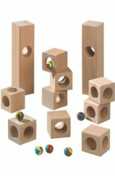 """Haba Marble Runs Edges by HABA. $30.39. Height: 2.17 in.. Length: 8.43 in.. Width: 6.38 in.. Weight: 1.46 lbs.. Age: 3 - 5 years. HABA 1148 - HABA 1148 - Each element will give a terrfic turn to the marble game. This set contains 6 corner blocks, 5 tunnel blocks and 6 marbles. Base measures 1.5"""" x 1.5"""". Made from solid hardwood. Compatible with all Haba building block sets (T.C. Timber not included). Recommended for 3 years and up. Made in Germany.Age: 3+Materials: woodM..."""