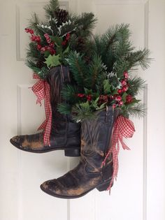 Vintage Cowboy Boot Christmas/Holiday Front Door Arrangement. Black boots with Faux Greens, Red Frosted Berries, Holly and Red Gingham bow.