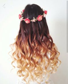 Dip dyed hair curly with a flower crown. Livening this hair style at the moment