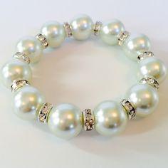 Gorgeous large pearl bracelet Pearl bracelet with silver rhinestones. White 14mm glass pearls. So pretty! Jewelry Bracelets