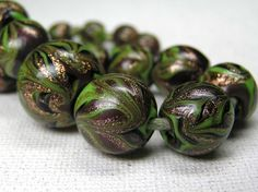 A strand of aventurine glass beads from Murano in Italy. Circa 1920. Posted by Sarah Corbett