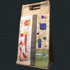 Upcycled wine carrier - stenciled, embroidered and appliqued.