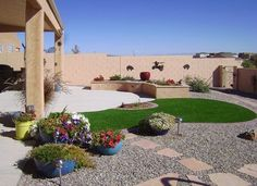 low water landscaping photos | Low Maintenance Backyard Small curve and round of grass and surrounded with rock, concrete and minimal plantings