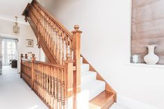 Four double bedroom, three bathroom, three reception townhouse set over three floors. This stunning property is stylish and immaculate throughout with an abundance of natural light. Wood staircase. Wood and carpet. White carpet. Carpet staircase.