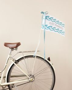 For a Beach Fete: a Just-Married Flag Forget tin cans tied to a car bumper, and hop onto a bicycle built for two with a trailing pennant spelling out your new status. Art Template, Planner Template, Decoration Inspiration, Wedding Inspiration, Wedding Ideas, Wedding Photos, Wedding Details, Wedding Signs, Our Wedding