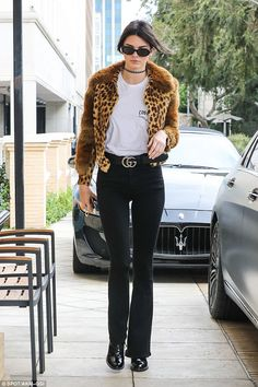 Model style: Kendall wore a leopard-print jacket over slim black trousers