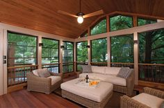 Three season porch with Eze-Breeze® windows (closed) and high tongue and groove ceiling. Back porch designed and built by Atlanta Decking & Fence.
