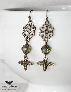 Gorgeous tiny bee charms dangle from these rather rustic vintage style bronze filigree earrings with olive green/brown czech glass beads. Would work