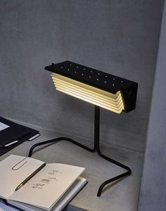The DCW Editions Biny Table Lamp, available from Inspyer Lighting, makes an excellent reading light and has adjustable fins that direct intense light to the subject.
