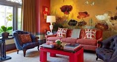I love the oranges and pinks in this room. The Poppy design on the wallpaper really brings an unusual and intriguing aspect to the overall feel.
