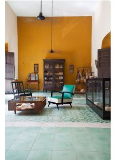 Mexican Casa via Lonny....love the saffron walls and minty/light blue floors combo. Cool turquoise chair too