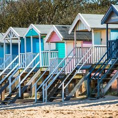 Colourful beach huts on Wells beach at Wells next the Sea on North Norfolk coast, East Anglia, England, UK.